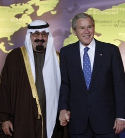 U.S. President George W. Bush greets Saudi Arabia's King Abdullah as he arrives at the G20 Summit in Washington